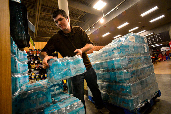 A store manager stocked shelves in Brattleboro, Vt., this month. Single-use plastic items are in high demand.