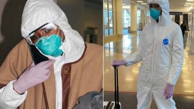 Photo of Coronavirus: Naomi Campbell wears full hazmat suit, face mask and gloves during flight