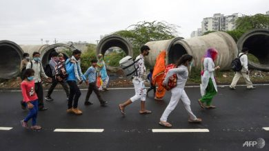 Photo of Stranded by coronavirus lockdown, India migrant workers walk home