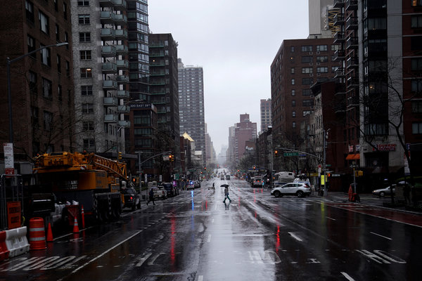 The combination of rain and social distancing led to the streets of New York City being largely empty on Monday.