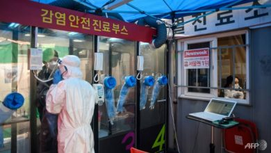 Photo of South Korea dials up COVID-19 testing with hospital 'phone booths'