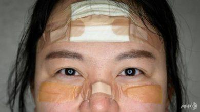 Photo of COVID-19: South Korean nurses' bandages become badges of honour