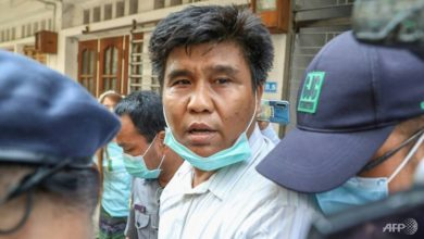 Photo of Myanmar journalist hit with terrorism charges for interviewing insurgents