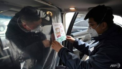 Photo of China reports 27 new virus deaths, fall in new cases