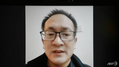 Photo of China rights lawyer vows fight to reunite with family