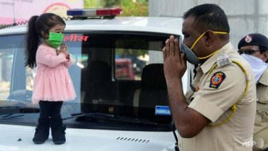 Photo of World's smallest woman in India stay-at-home virus appeal