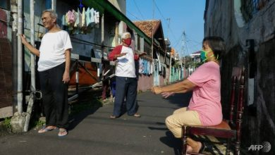 Photo of Indonesians soak up sun's rays to battle COVID-19