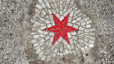 Photo of Chicago artist fills pesky potholes with pandemic art amid COVID-19