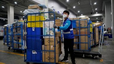 Photo of COVID-19 outbreak at South Korea e-commerce warehouse drives spike in new cases