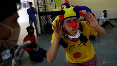 Photo of COVID-19: Clowns visit Indian shelters, briefly giving stranded migrants a laugh