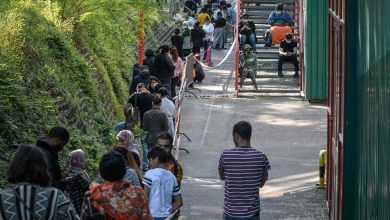 Photo of Food Line in Geneva Stretches To More than 1,500 People