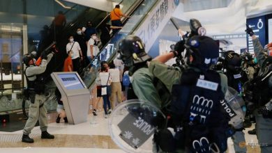 Photo of Hong Kong police chief admits 'undesirable' behaviour towards media at protest