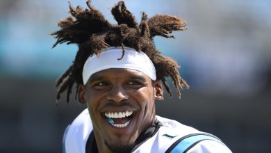 Photo of Cam Newton's signing conveniently buries Patriots punishment news