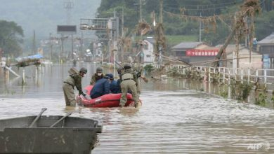 Photo of Japanese rafters paddle against the floods amid torrential Kyushu rains
