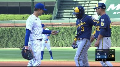 Photo of Wash your hands: Cubs' Rizzo lends hand sanitizer to Brewers' Arcia
