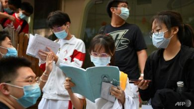 Photo of Chinese students take college exam after COVID-19 delay