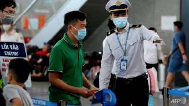 Photo of Vietnam curbs movement in city of 1.1 million as virus-free run ends