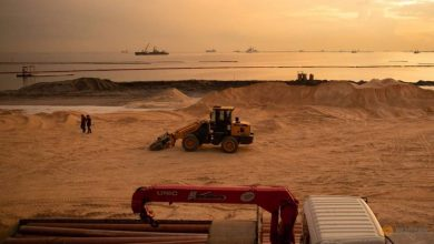 Photo of Polluted stretch of Manila Bay gets fake white sand makeover