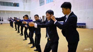 Photo of China's rich seek bodyguards schooled in digital dark arts