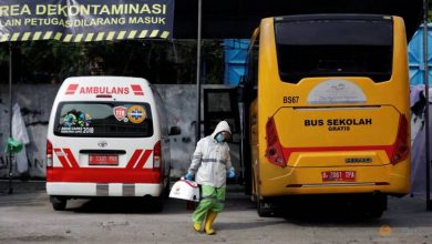 Photo of With schools shut, Indonesian bus drivers ferry COVID-19 patients instead