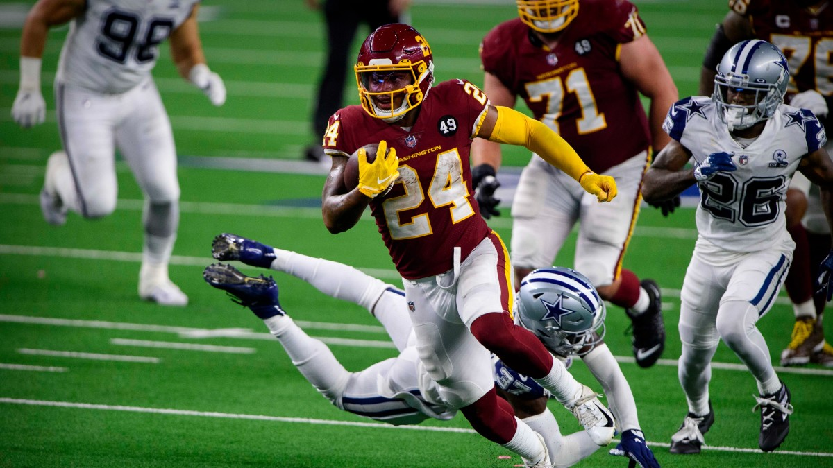Washington Football Team running back Antonio Gibson (24) runs for a touchdown against the Dallas Cowboys during the second half at AT&T Stadium.