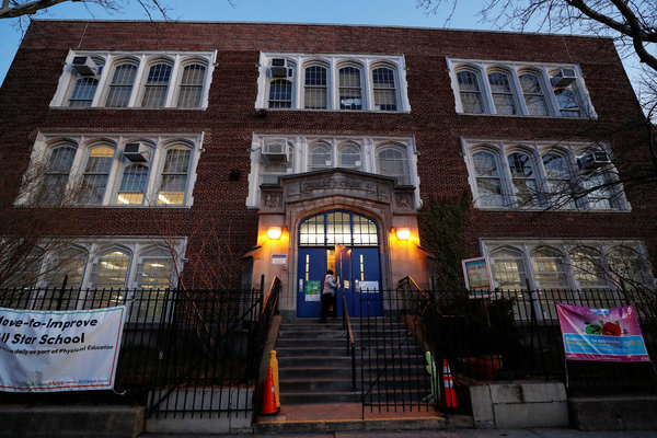 Schools like P.S. 41 in Queens are closed for the next month, but teachers and other employees were arriving early this morning to prepare for next week's launch of online learning.