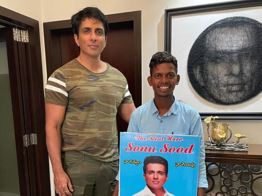 Sonu Sood with a fan who walked from Hyderabad to Mumbai to meet him