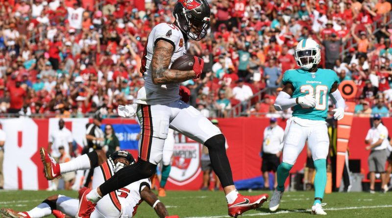 Oct 10, 2021; Tampa, Florida, USA; Tampa Bay Buccaneers wide receiver Mike Evans (13) scores a touchdown in the second half against the Miami Dolphins at Raymond James Stadium. Mandatory Credit: Jonathan Dyer-USA TODAY Sports
